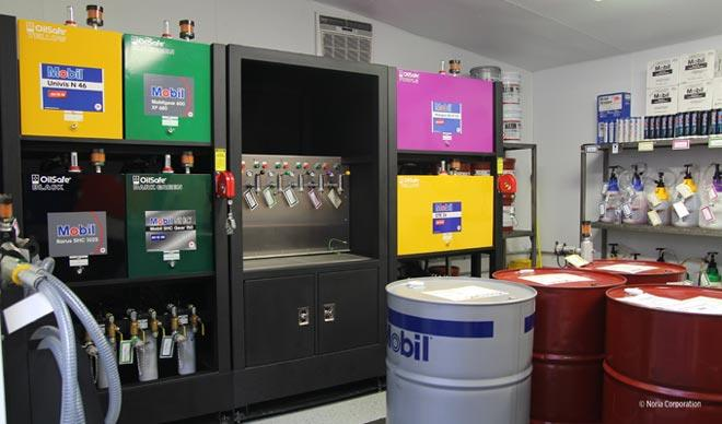 Oil storage containers and dispensing systems
