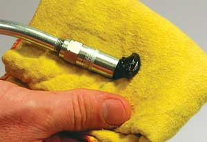 Always make sure the dispensing nozzle of the grease gun is clean before using.