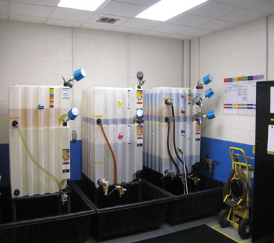 The company's new lube storage room has dedicated storage totes, a communications corner, clear grease guns with calibration stickers, an oil matrix that details which oil goes in which machine, and oil transfer jugs that are tagged and color-coded.